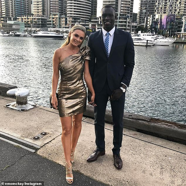 11996612-6902989-Majak_Daw_and_Emily_McKay_in_Melbourne_s_Docklands_in_October_20-a-18_1554817...jpg